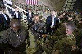 Barack Obama was cheered by soldiers during a surprise visit to Bagram Airfield outside Kabul