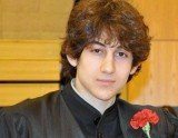 Dzhokhar Tsarnaev wrote a note as he emerged from the boat where he had hidden from investigators
