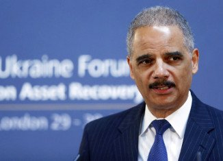 Eric Holder said the US government categorically denounces economic espionage as a trade tactic