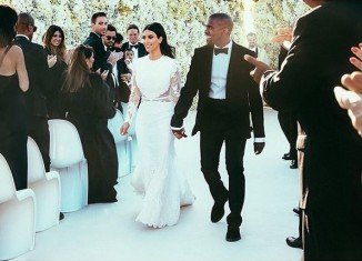 Kim Kardashian has changed her name to Kim Kardashian West after marrying Kanye West in Florence