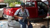 Mexico has begun to swear in members of self-defense groups for its newly created rural police