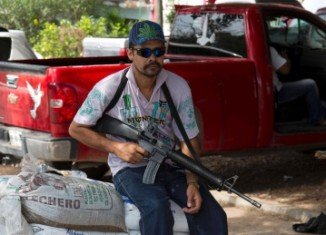 Mexico has begun to swear in members of self-defense groups for its newly created rural police force in Michoacan