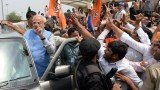 Narendra Modi was cheered by supporters after a victory parade from Delhi airport