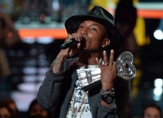 Pharrell Williams was teary-eyed as he accepted the Innovator award at the inaugural iHeartRadio awards in Los Angeles