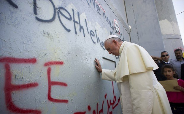 Pope Francis has prayed at Bethlehem wall during his three-day tour of the Middle East