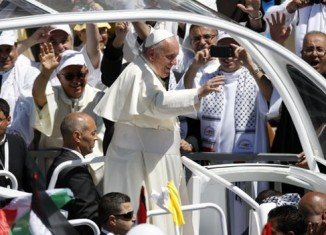 Pope Francis is holding an open-air mass for 8,000 local Christians by Bethlehem's Church of the Nativity