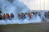 Riot police fired tear gas at anti-World Cup and indigenous demonstrators in Brasilia