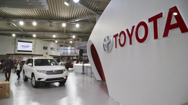 Toyota has seen its profits nearly double, boosted by the Japanese yen's weakness and cost cutting