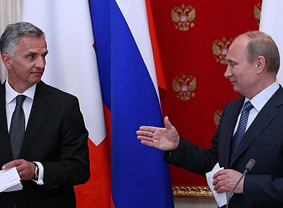 Vladimir Putin met Didier Burkhalter, the Swiss president and current chairman of the OSCE, in Moscow