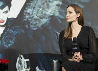 Angelina Jolie has said her security arrangements will not change following Vitalii Sediuk's red carpet prank on Brad Pitt