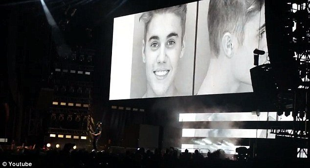 Beyonce and Jay-Z feature Justin Bieber's mugshot in On the Run tour footage