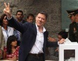 Juan Manuel Santos has been re-elected as Colombia's president in the most dramatic presidential