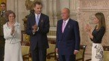 King Juan Carlos of Spain signed the bill of his abdication in favor of his son, Crown Prince Felipe