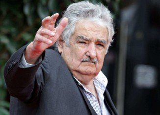 President Jose Mujica has insulted FIFA over Luis Suarez's four-month ban