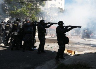 Sao Paulo riot police have used tear gas to break up a protest against Brazil's World Cup, hours before the opening match