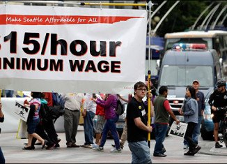 Seattle council has voted unanimously to raise the city's minimum wage to $15