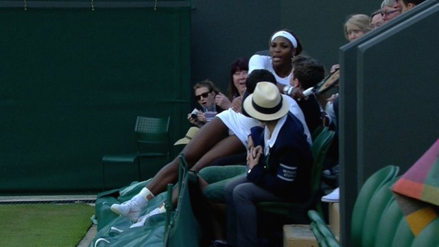 Serena Williams ran out of space during her Wimbledon double match and fell into the lap of a spectator