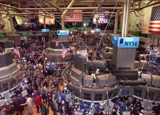 Stock markets dipped in early Monday trading as fresh data presented a mixed economic picture in the US