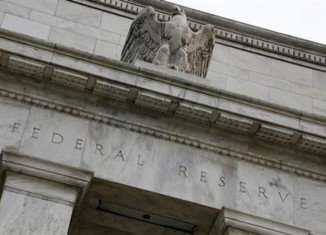 The Fed has cut its growth forecast for 2014 due to the harsh winter weather