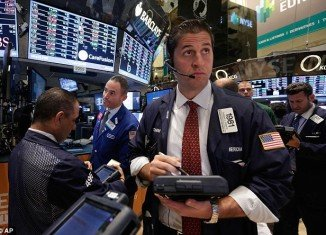 US shares closed at record levels, helped by strong data on the manufacturing sector