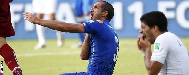 Uruguay's striker Luis Suarez appeared to bite Italy's Giorgio Chiellini during their Group D clash at the World Cup tournament in Brazil