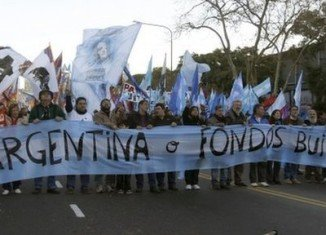 Argentina can't afford to pay the so-called hold-out creditors and risks a new bond default