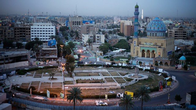 At least 29 people have been killed after gunmen have stormed two buildings in Baghdad's neighborhood of Zayouna
