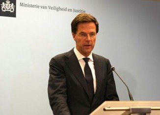 Dutch PM Mark Rutte says sending out an international military force to secure the site of the downed Malaysian Airlines jet in eastern Ukraine is unrealistic
