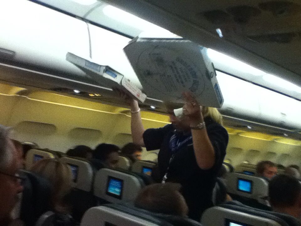 Frontier Airlines pilot Gerhard Brandner orders pizza for a
