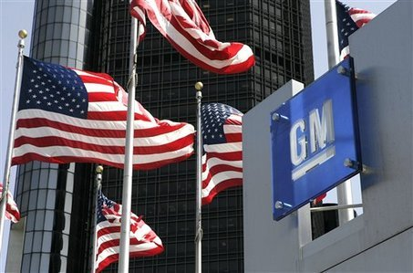 General Motors' earnings have slumped because of costs related to its vehicle recalls photo