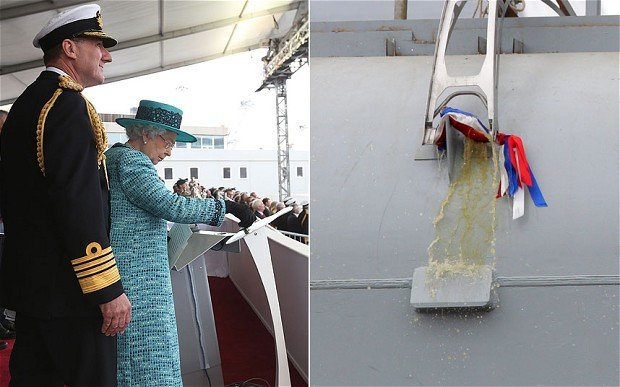 HMS Queen Elizabeth has been named with a bottle of whisky smashed on the hull of the 65,000-tonne vessel