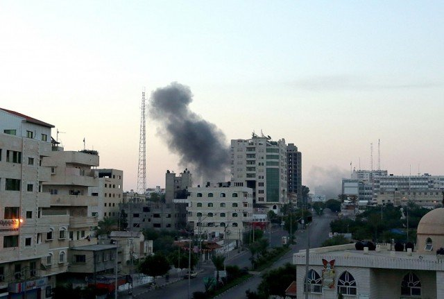 Israel's overnight air strikes hit Gaza's security headquarters and police stations, in the heaviest bombardment since operations began on July 8