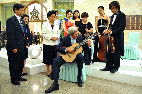 John Kerry played a musician's guitar following a lunch at the Great Hall of the People in Beijing