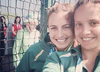 Queen Elizabeth II popped up in the background as two Australian Commonwealth Games hockey players were posing for a selfie