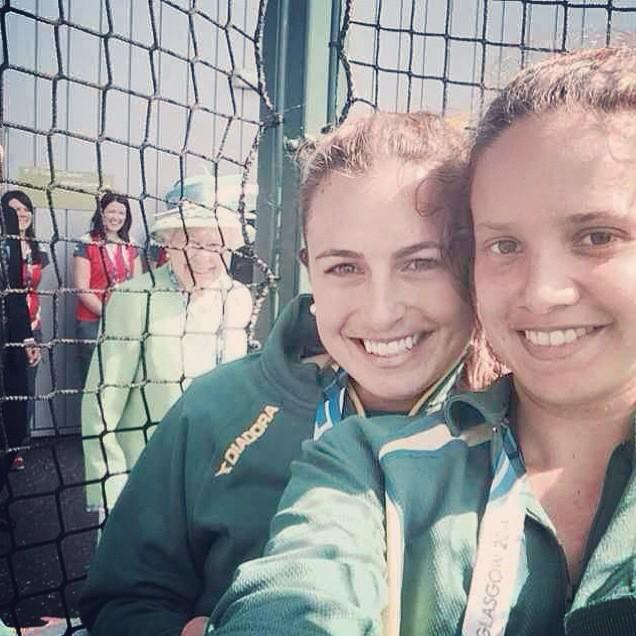 Queen Elizabeth II popped up in the background as two Australian Commonwealth Games hockey players were posing for a selfie photo