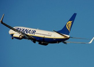 Ryanair has raised its annual profit forecast after seeing net income more than double for the Q2 2014
