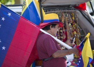 The US government is imposing travel restrictions on a number of Venezuelan officials