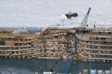 The wrecked Costa Concordia cruise ship is being towed on its final journey to the port of Genoa for scrapping