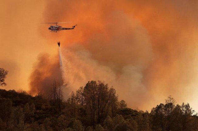 Two fast-moving wildfires in California are threatening homes and could result in the evacuation of hundreds of people