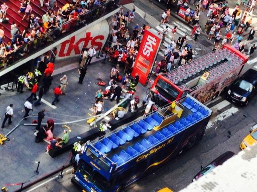 At least 14 people have been injured after two double-decker buses collided in Times Square