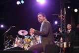 Derek Rieth played many percussion instruments for Pink Martini, including bongos, congas, cymbals, and the triangle