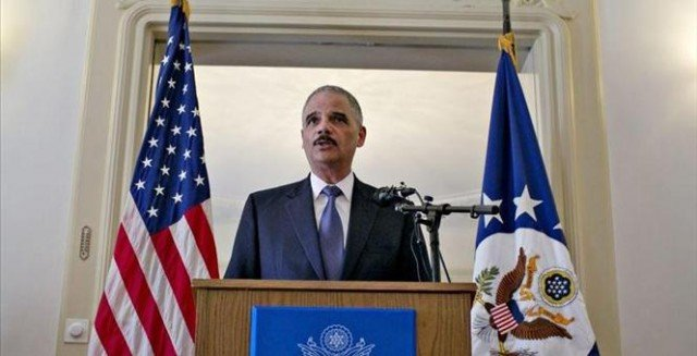 Eric Holder has promised a full, fair and independent investigation into Michael Brown's death as he arrived in Ferguson