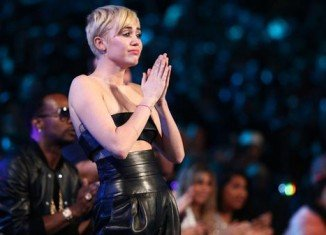 Miley Cyrus let a homeless man accept her award for video of the year at the MTV VMA's 2014