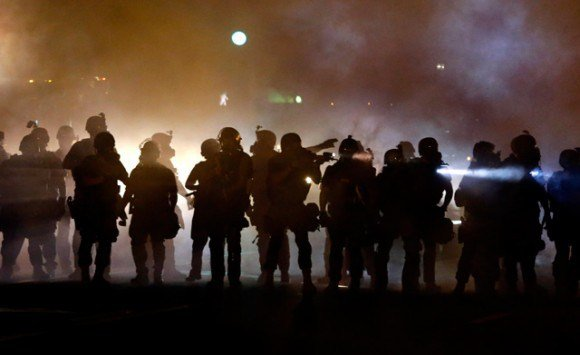 More than 150 people broke the overnight curfew imposed in Ferguson