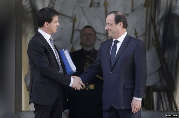 President Francois Hollande has named a new cabinet under PM Manuel Valls photo