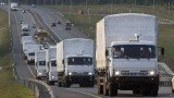 Russian convoy trucks carrying aid to eastern Ukraine have reached a border post controlled by rebels