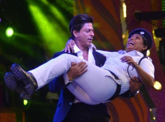 Shah Rukh Khan sparked controversy after dancing on stage with a woman officer at a police gala in West Bengal state