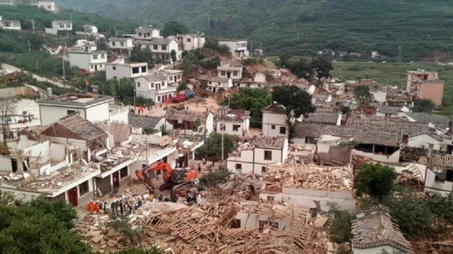 The 6.1-magnitude quake struck a mountainous area, destroying thousands of houses and triggering landslides