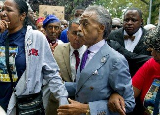 The Staten Island march was led by the Rev. Al Sharpton and relatives of Eric Garner