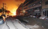 The blasts rocked the city's Cianjhen district, scattering cars and blowing deep trenches in roads